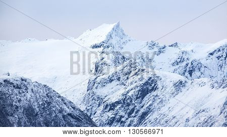Mountains covered with snow in the cold arctic environment.