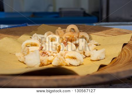 Close up of calamari rings fried food on tray