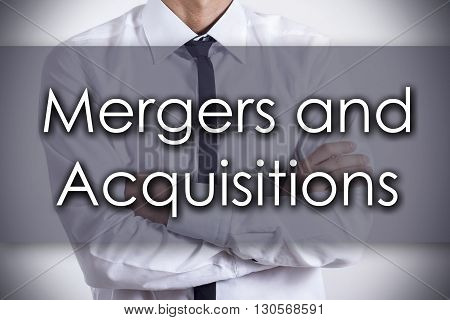 Mergers And Acquisitions - Young Businessman With Text - Business Concept