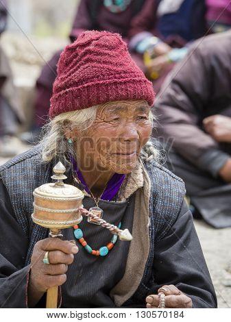 LAMAYURU INDIA - JUNE 13 2015: Unidentified buddhist old women during mystical mask dancing Tsam mystery dance in time of Yuru Kabgyat Buddhist festival at Lamayuru Gompa Ladakh North India
