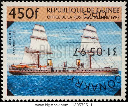 MOSCOW RUSSIA - MAY 08 2016: A stamp printed in Guinea shows battleship of the Royal Navy Fleet UK