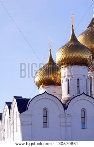 detailed bright Golden domes of Orthodox churches in the sunlight