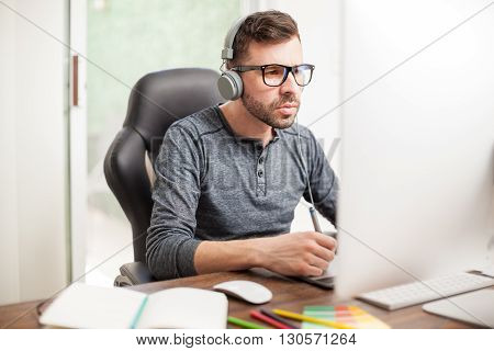 Designer Using Headphones In The Workplace