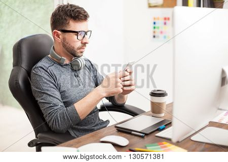 Young Man Texting At The Office