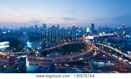 Blurred bokeh lights, Highway interchanged and city downtown background after sunset