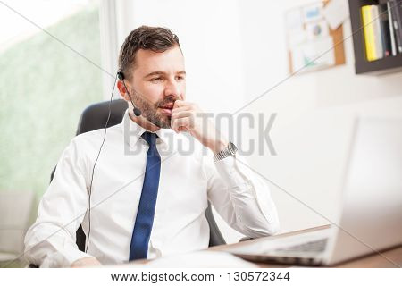 Customer Service Rep Working In An Office