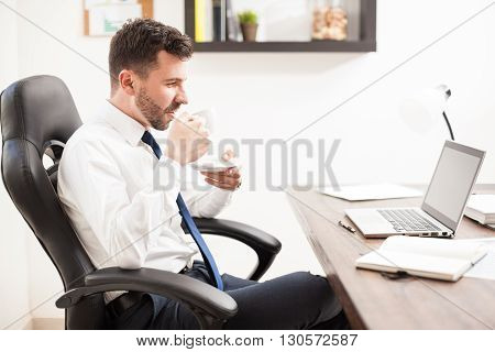 Businessman Enjoying A Cup Of Coffee