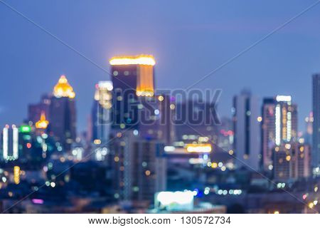 Abstract blurred bokeh, Business tower lights at twilight