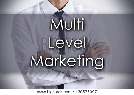 Multi Level Marketing Mlm - Young Businessman With Text - Business Concept