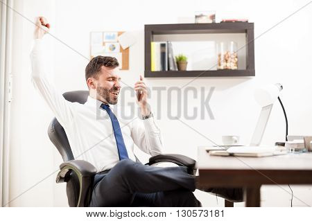 Businessman Getting Great News On The Phone