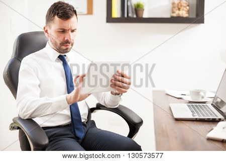 Businessman Multitasking In The Office