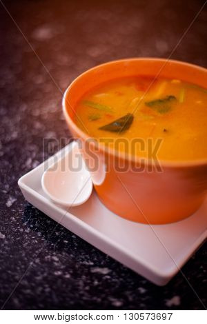 Fresh made hot and sour soup Tom Yum with prawns. Traditional thai cuisine.