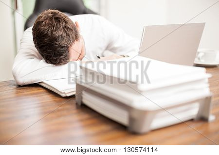 Exahusted Businessman Sleeping At The Office