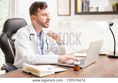 Young Doctor Using A Laptop In An Office