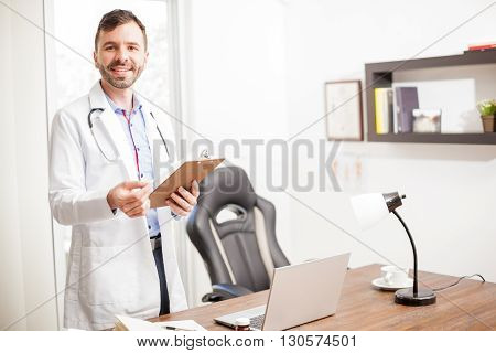Hispanic Doctor Welcoming You In His Office