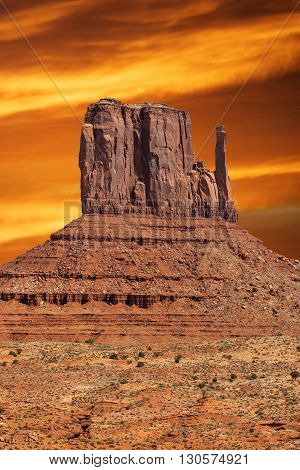 famous rock formation in monument valley at sunset