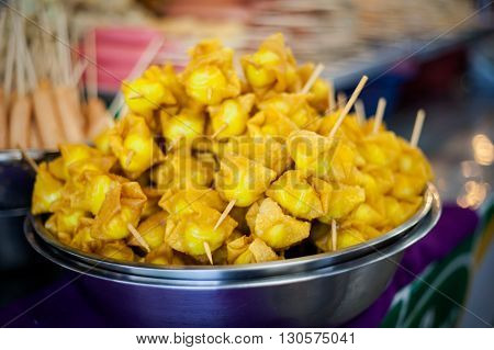 Fresh fried asian dumplings Dim Sum filled with minced meat on skewer. Traditional thai cuisine.