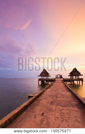 Walking path leading to abandon temple in the sea with beautiful sky background