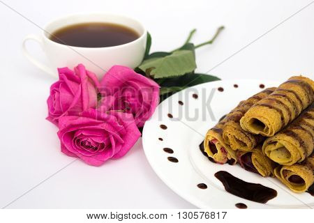 Cup of coffee, pancakes and pink roses
