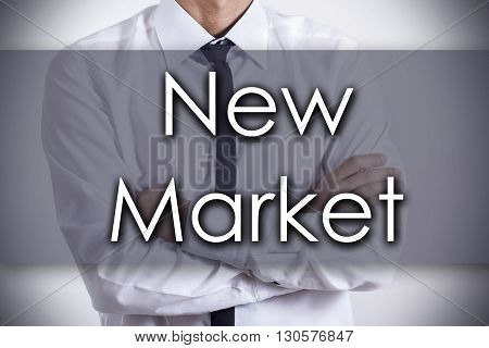 New Market - Young Businessman With Text - Business Concept