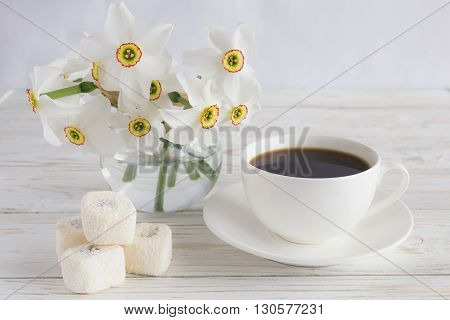 Cup Of Coffee, Rahat Lokum With Coconut And Narcissus On White Wooden Background