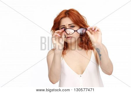 Young Woman watching into glasses Isolated On White Background