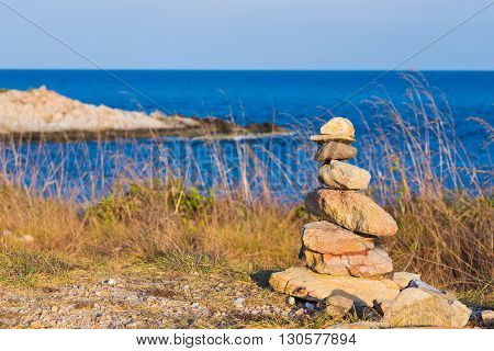 Stone stacks on boulder beach with skyline background
