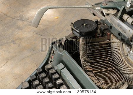 Typewriter antique vintage style on a old wood table