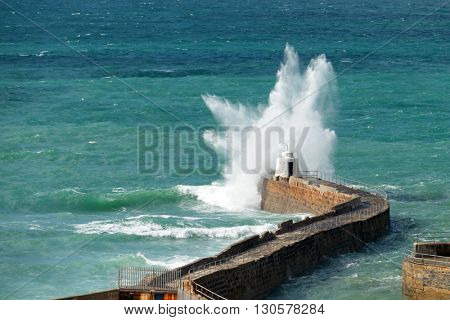 Portreath pier big white water wave splash, Cornwall England.