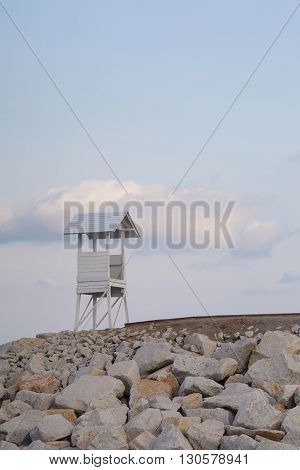 Small white lifeguard with blue sky background