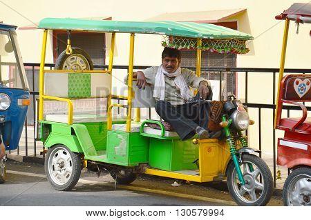 auto rikshaw puller man colorful rajasthan india