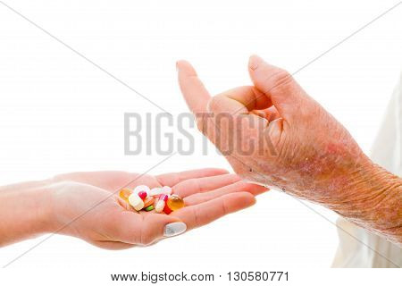 Rude refusal of drugs by senior patient.