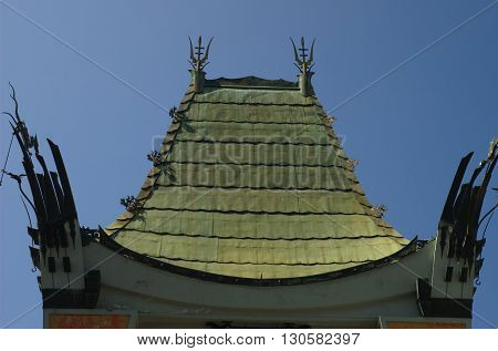 a picture of an exterior 1920's building copper plated roof