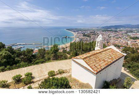 Mediterranean sea, blue sea view from Blanes. White saint John church and the mediterranean.