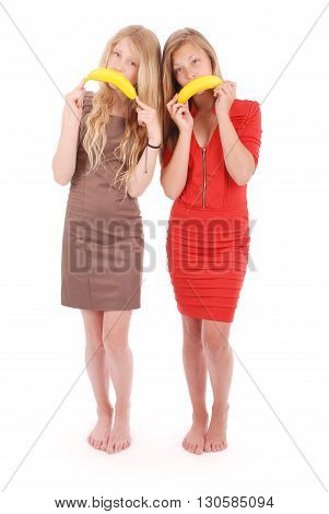 Two beautiful young caucasian girl with banana smile isolated on white