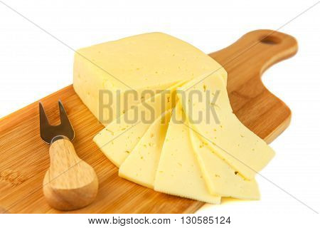 Block of tasty cheese and slices on cutting board with a knife isolated on white background