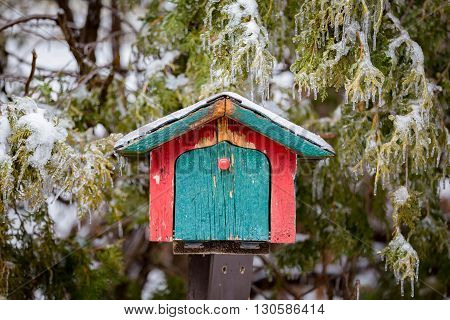 red and green hut mail box with icy green treen