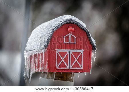 close up of red hut icy mail box