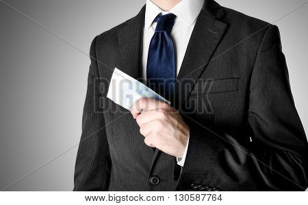 Businessman with blue tie holding twenty euro bank notes.