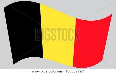 Flag of Belgium waving on gray background