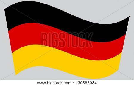 Flag of Germany waving on gray background