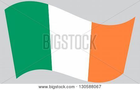 Flag of Ireland waving on gray background