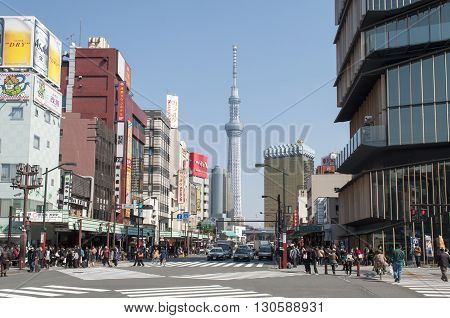 TOKYO, JAPAN - MARCH 17,2014: View of Tokyo Tower from the street on March 17, 2014. Tokyo, Japan.