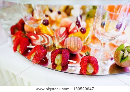 Elegance Wedding Reception Table With Food And Decor. Strawberry And Other Fruits On Table