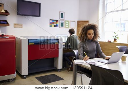 Staff In Design Office With CAD System For Laser Cutter