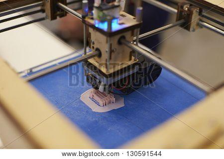 Close Up Of 3D Printer Operating In Design Studio