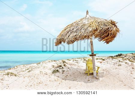 Grass umbrella at the beach on Aruba island  in the Caribbean