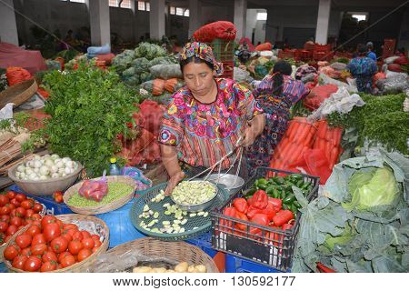 QUETZALTENANGO GUATEMALA april 28 2016 : Woman sale fruits in Quetzaltenango maket. This native market is the most colorful in Central America