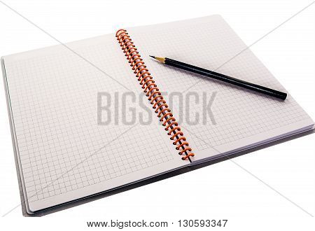 Pencil lying on the opened notebook on white background