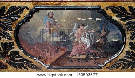 KOTARI, CROATIA - SEPTEMBER 16:The angel and the devil fight for the soul, Saint Joseph altar in the church of Saint Leonard of Noblac in Kotari, Croatia on September 16, 2015.